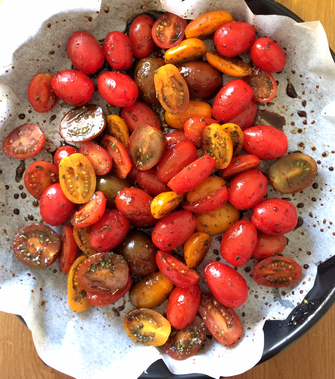 cherry tomatoes, ready to be reduced in the oven