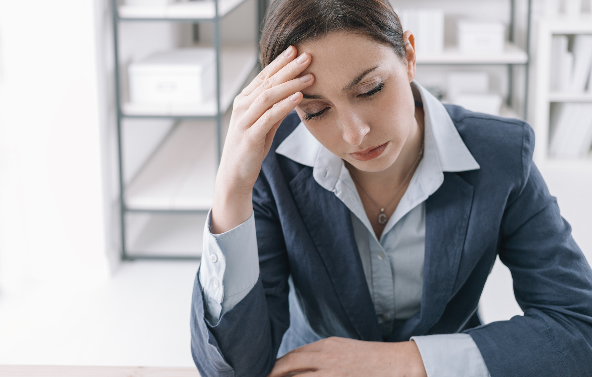 exhausted-businesswoman-in-the-office-PG5KD8Q.jpg