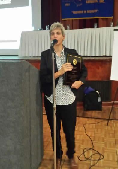 Jody Silver receiving the Brendan Nugent Leadership Award