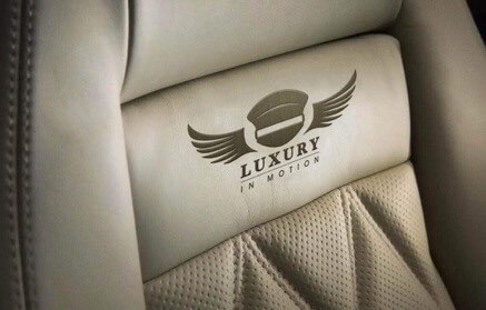 Luxury-in-motion-chauffeur-service-surrey-benefits-leather-seat-logo.jpg