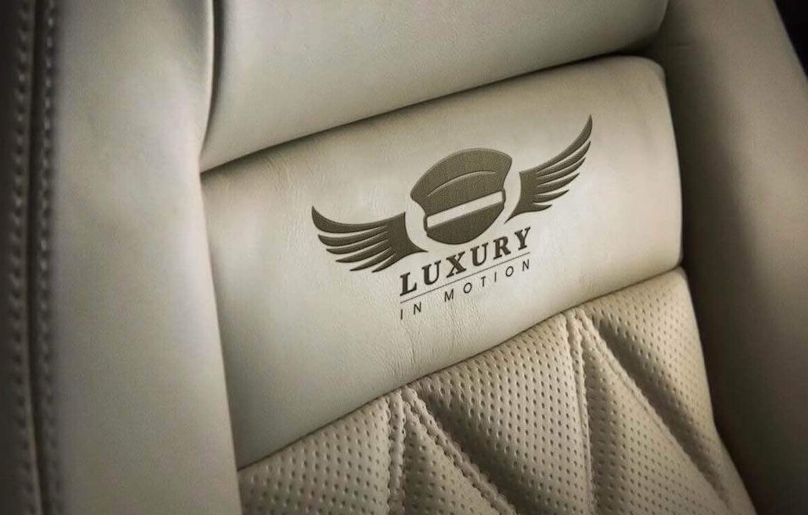 Luxury-in-Motion-kent-4x4-wedding-car-hire-leather-seat-logo.jpg