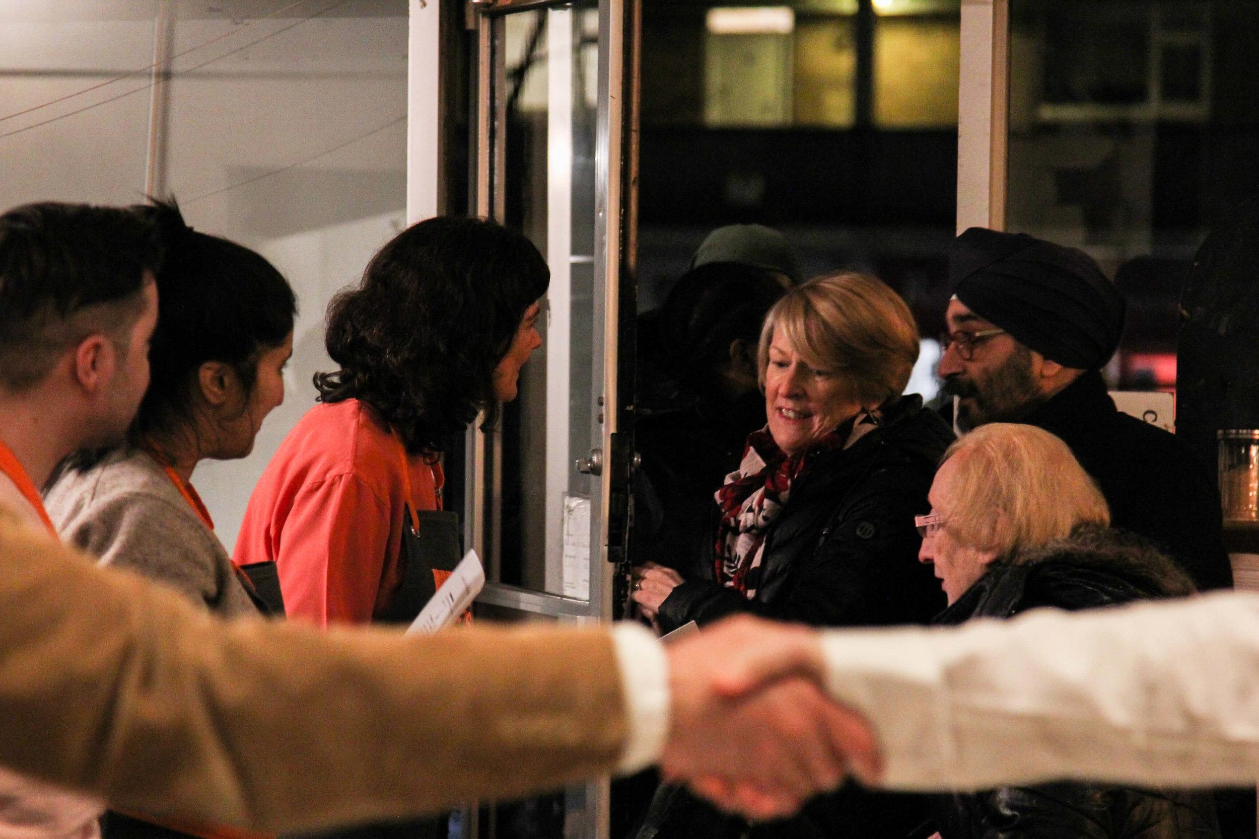 Guests arrive. shaking hands.jpg