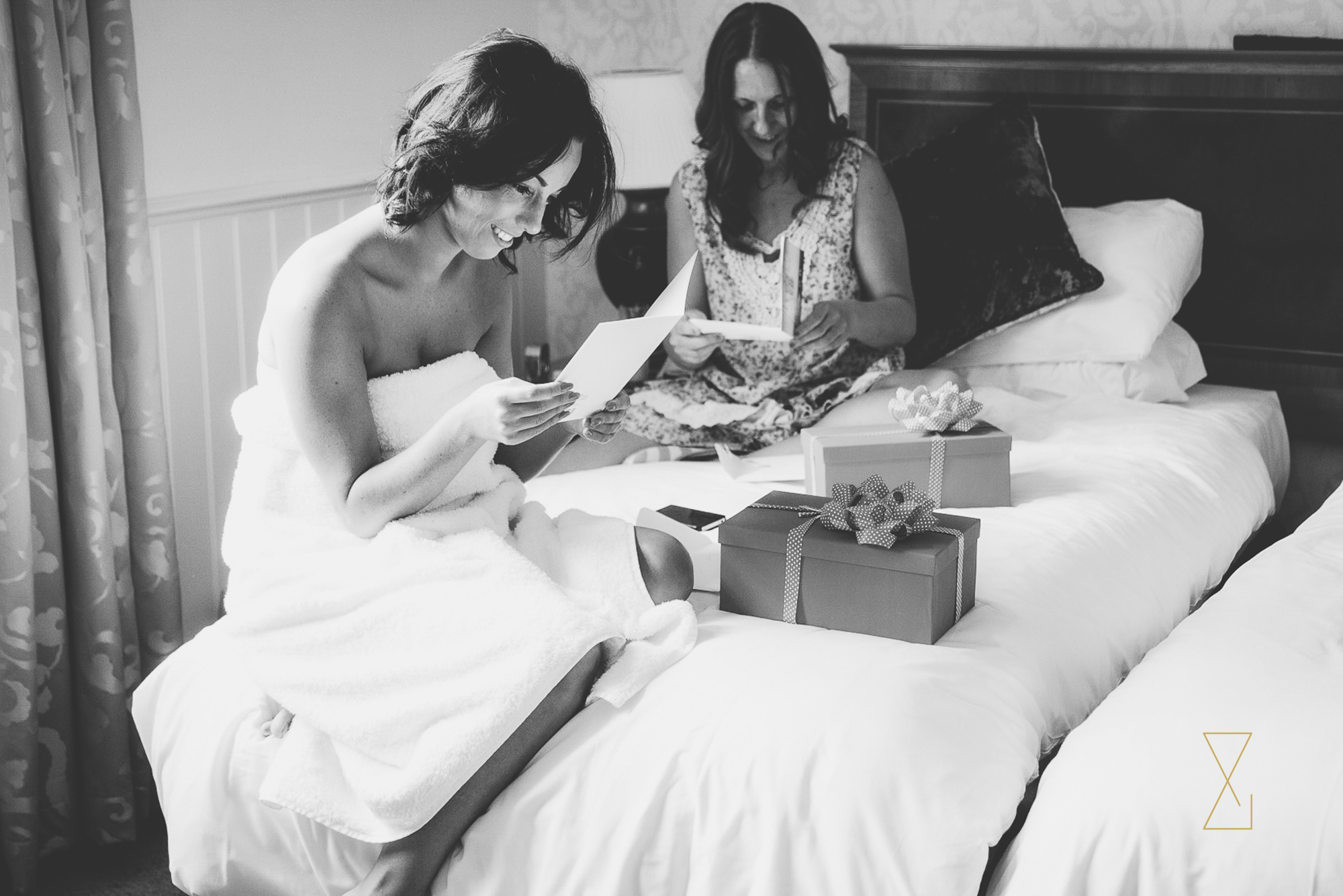 Bridesmaids open gifts from the bride, Evans & Evans wedding photography