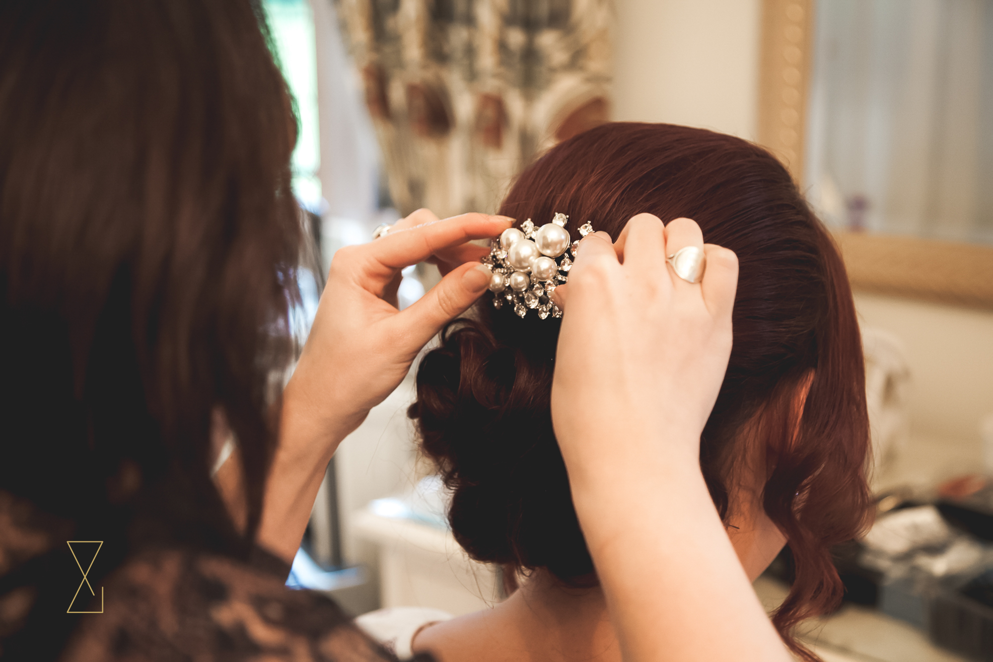 The bride having her hair decoration fitted at Colshaw Hall, Evans & Evans wedding photography