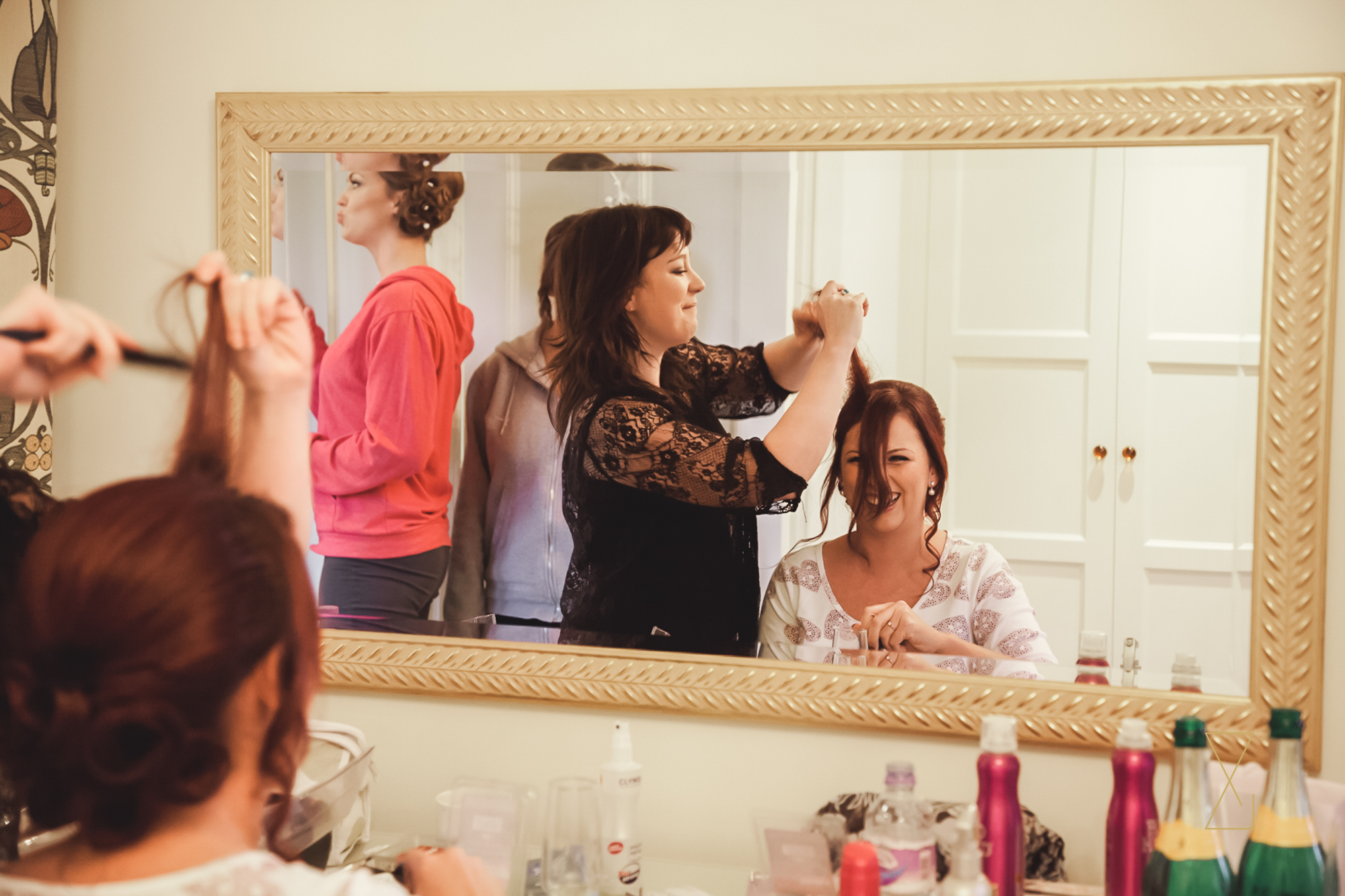Bride having fun as she gets ready at Colshaw Hall Cheshire, Evans & Evans wedding photography