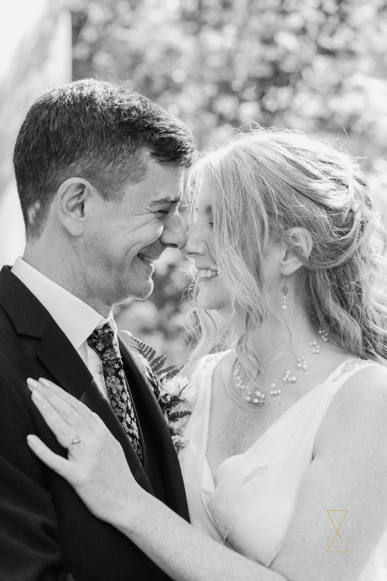 Laughing-bride-and-groom-portrait-Evans-and-Evans-wedding-photography-Cheshire.jpg