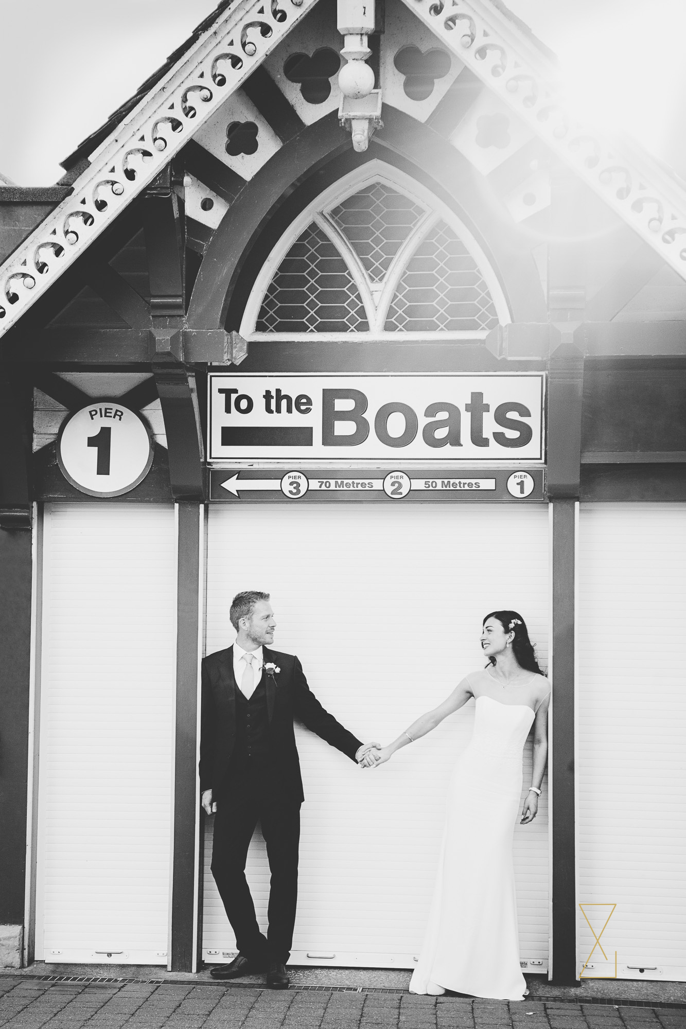 Bride-and-groom-at-the-boathouse-Laura-Ashley-Belsfield-Evans-and-Evans-wedding-photography-Lake-District-wedding.jpg