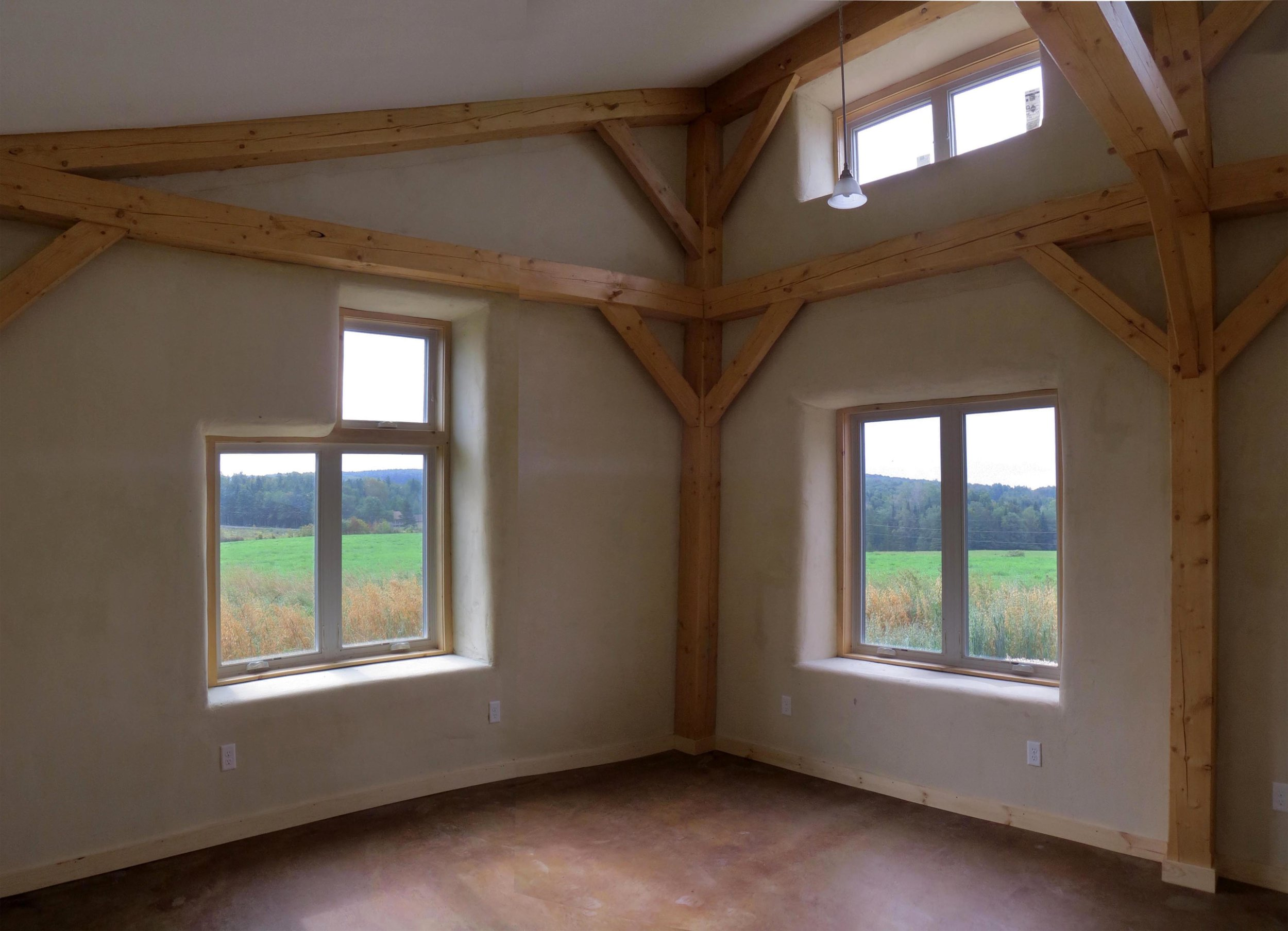 View of interior living area looking out onto the meadow beyond.