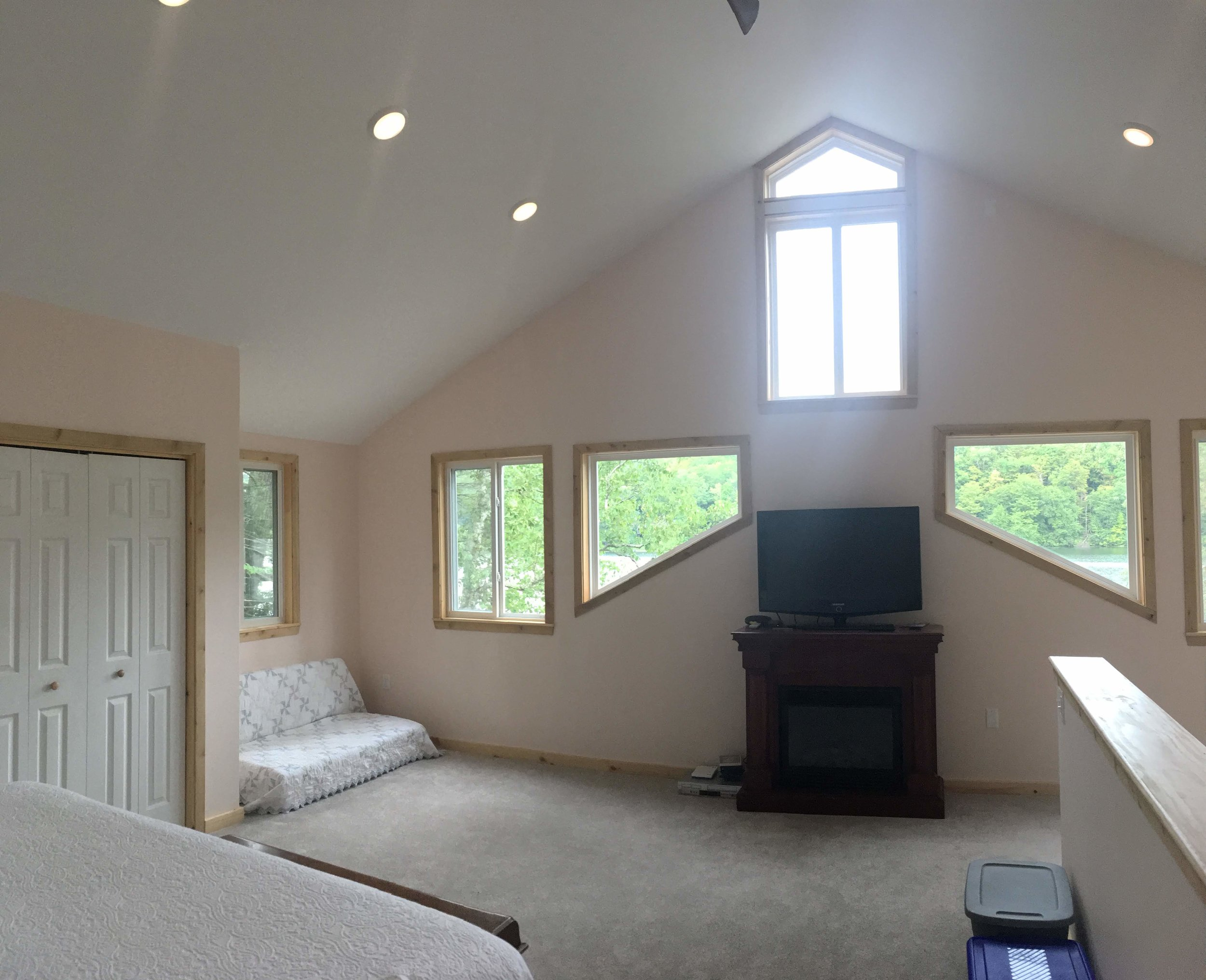 Upstairs Master bedroom suite with view to Pond.