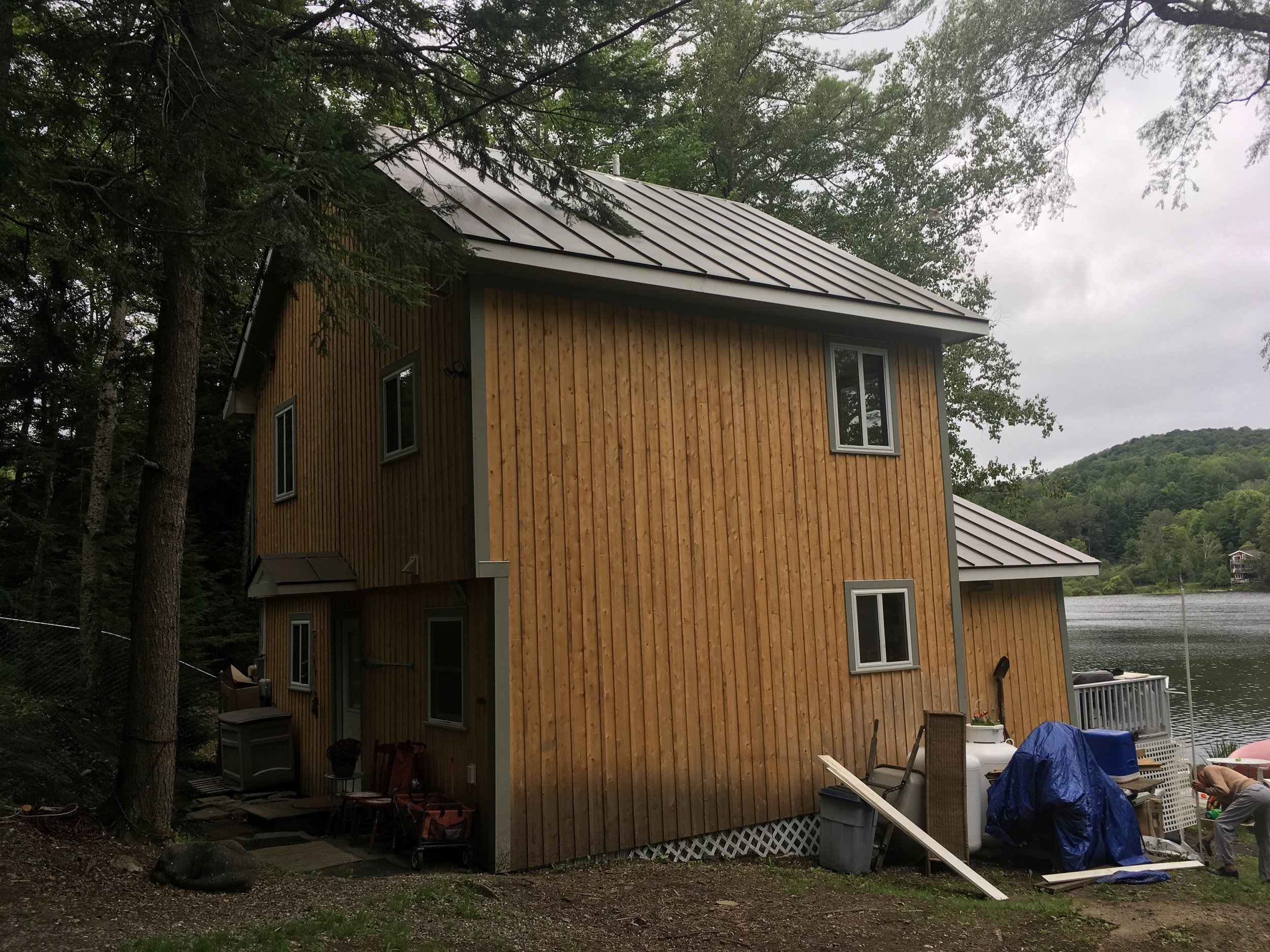 Rear view of now two-story renovated camp. (With exterior trim work still underway)