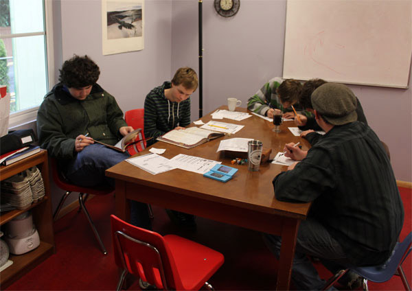 Students studying in the kitchen.