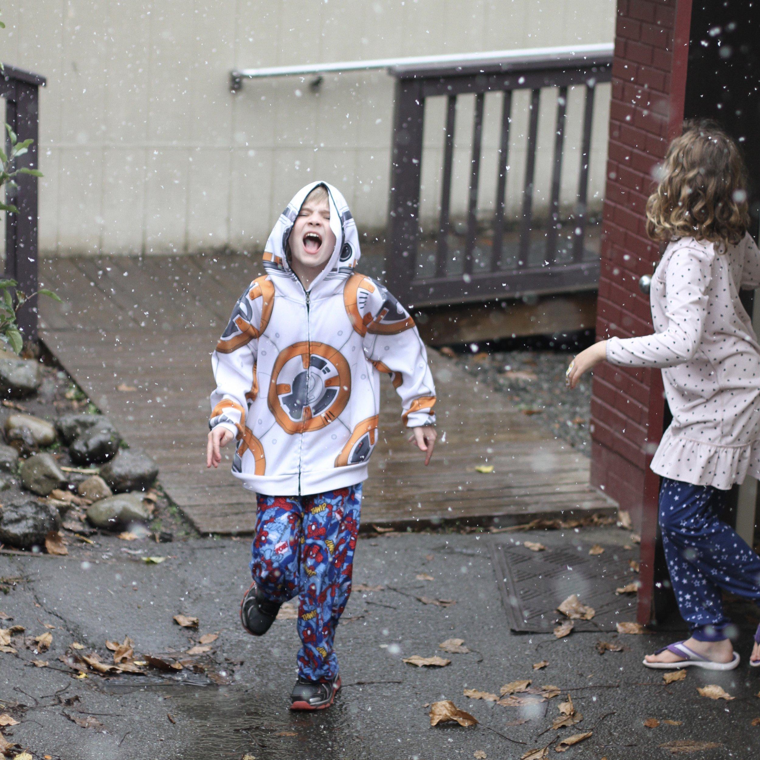Child enjoying the snow at school. Seattle area democratic-free school/sudbury school.