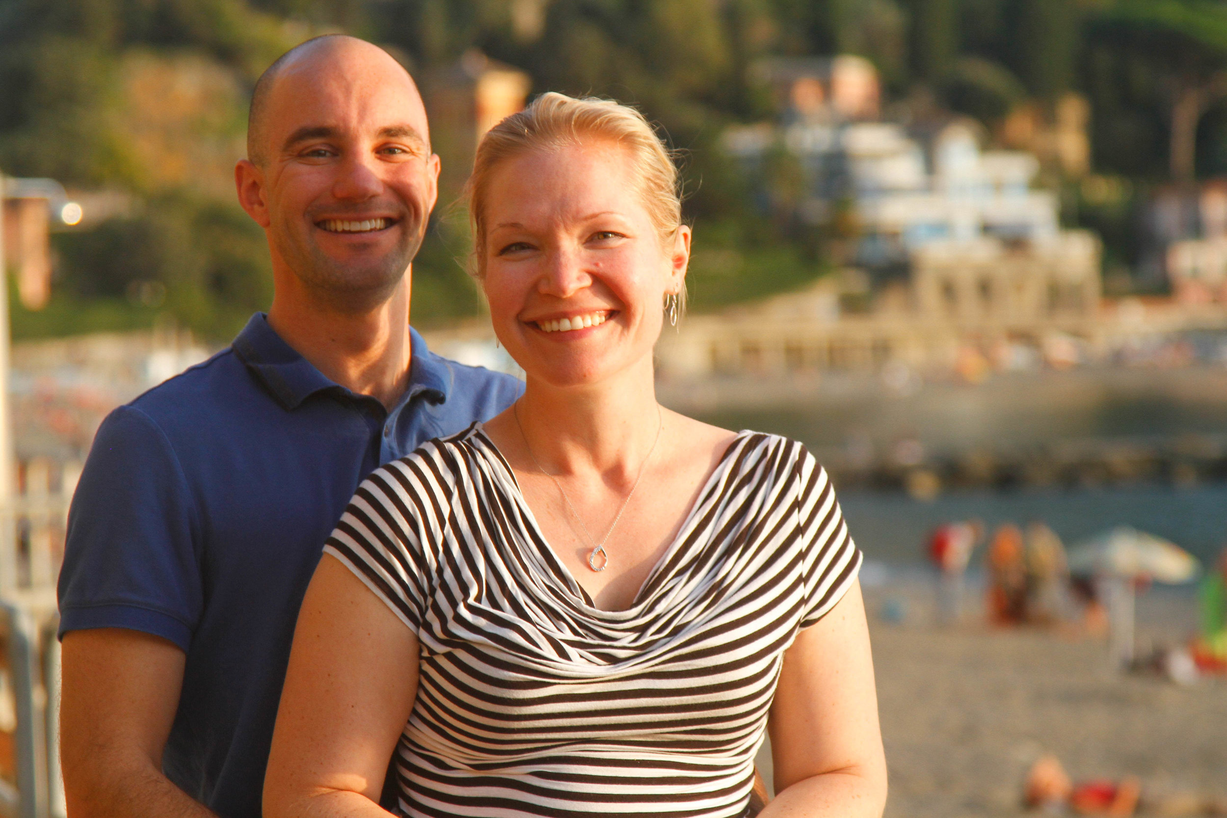 a satisfied couple enjoys a sunny afternoon on one of the beaches of the cinque terre.