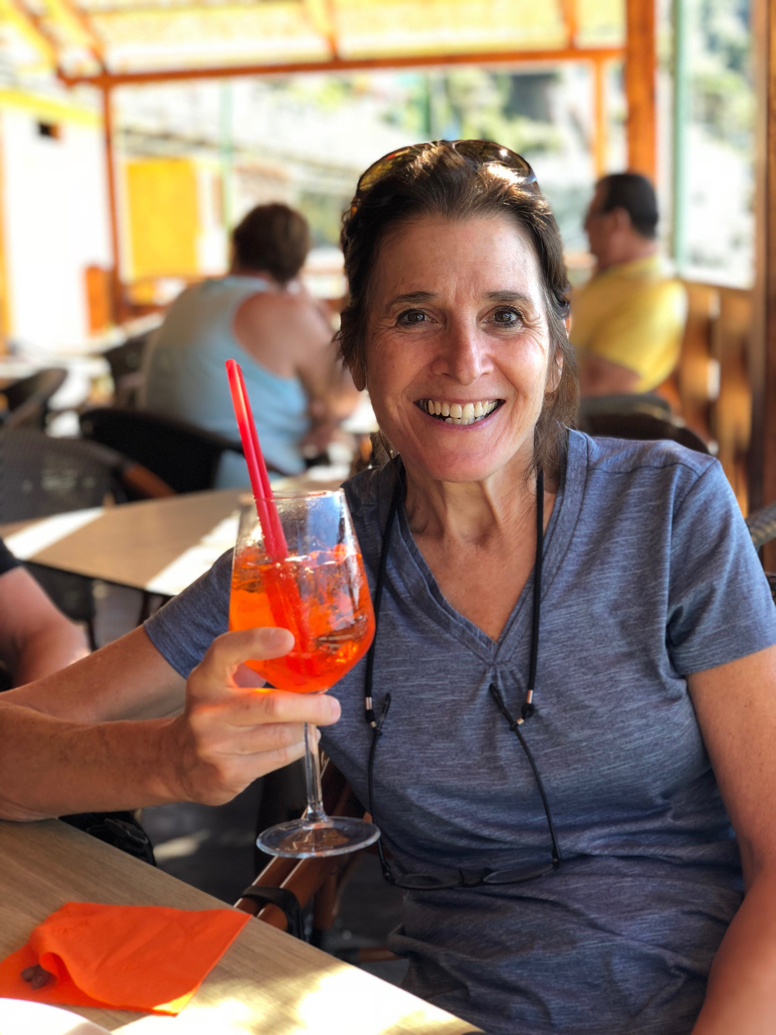 jo rewards herself with a spritz after biking along the ligurian coast