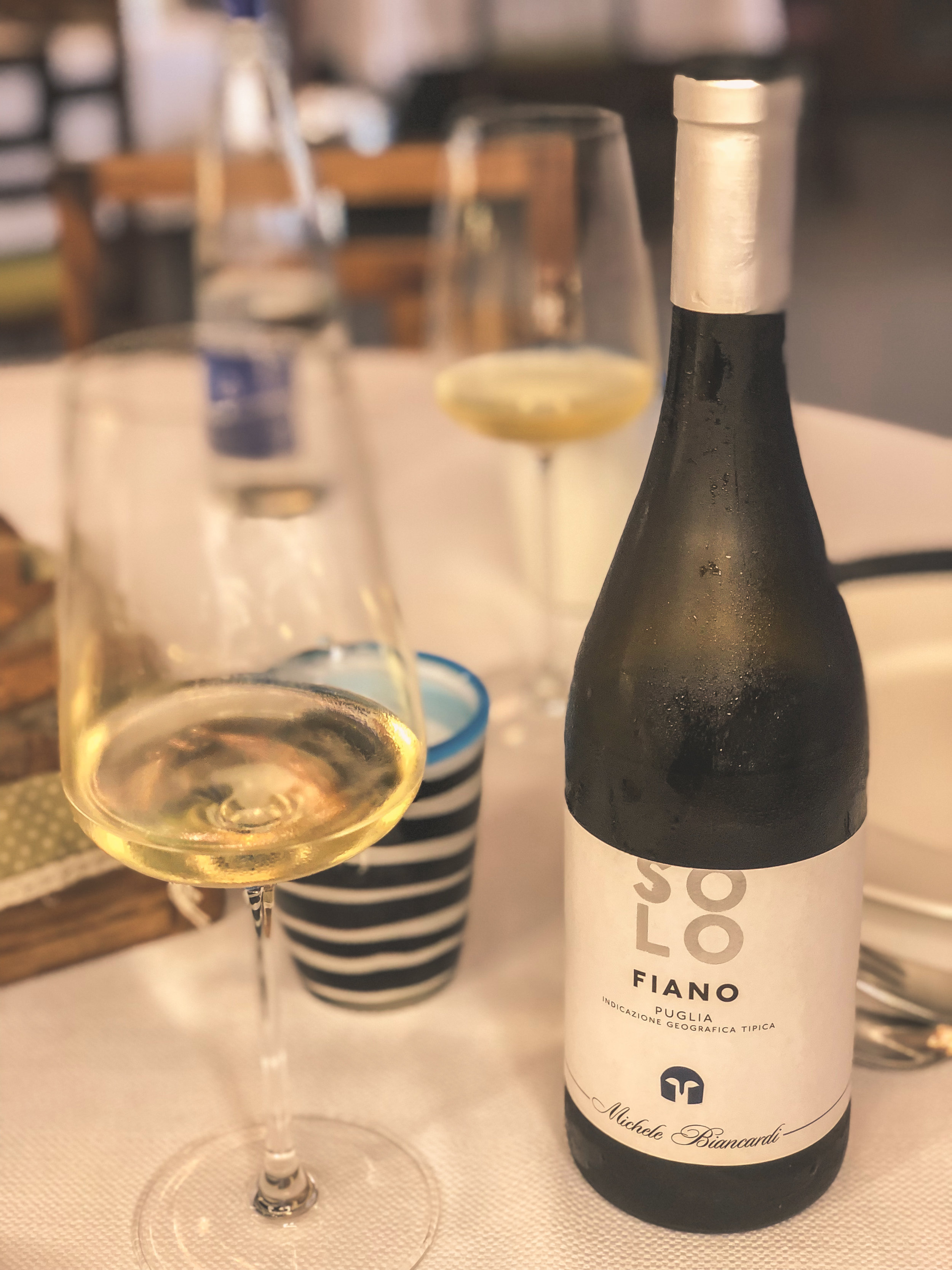 the bottle of wine we chose to accompany our puglian lunch. this crisp white wine is made from the fiano grape grown primarily in the campania region and on the island of sicily. NEEDLESS TO SAY IT WAS YUMMY!