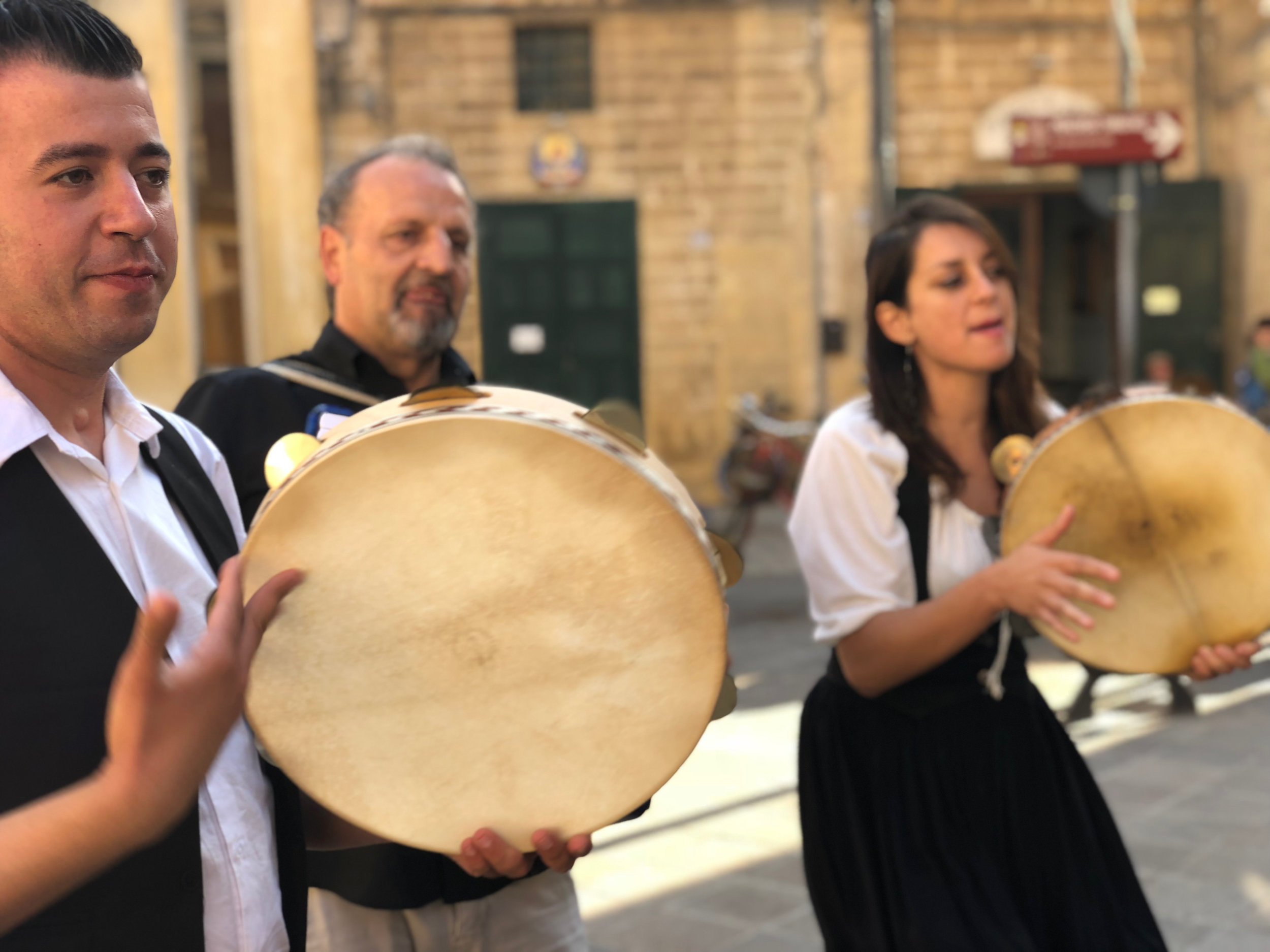 musicians performing the typical pizzica music/dance from salento. THIS FOLLOWING OUR COOKING CLASS AT COOK IN PUGLIA BY YLE TOURS.