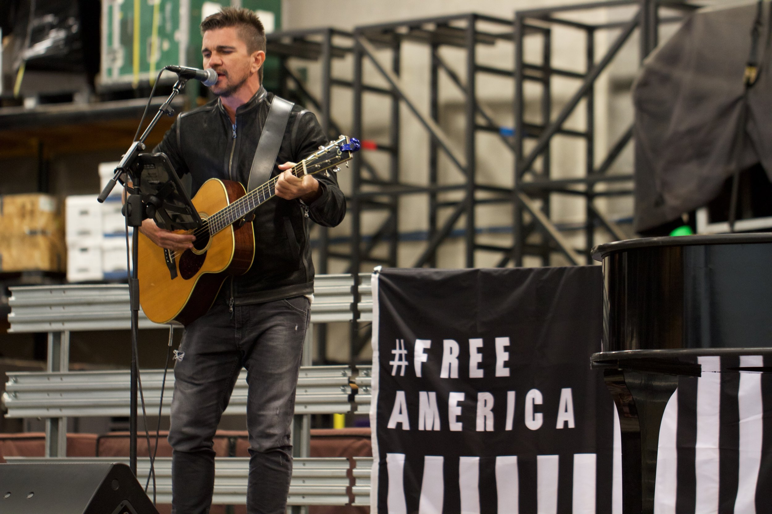 Sound check. Juanes joins John Legend to perform/protest outside Eloy.  Photo by Imani Lindsey