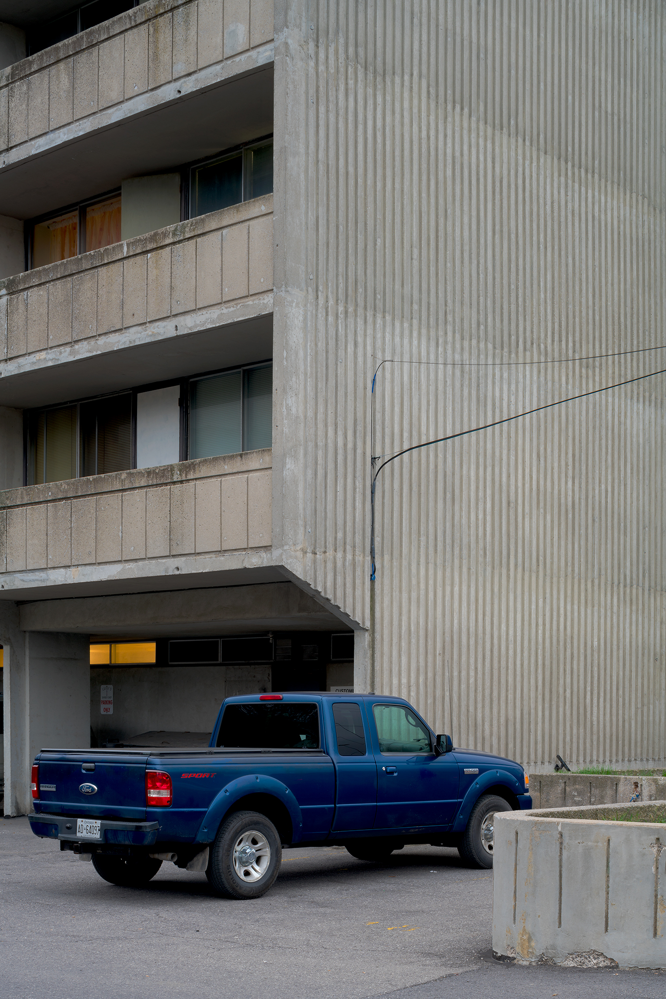 Brutalist concrete and pickup truck. Lees Avenue