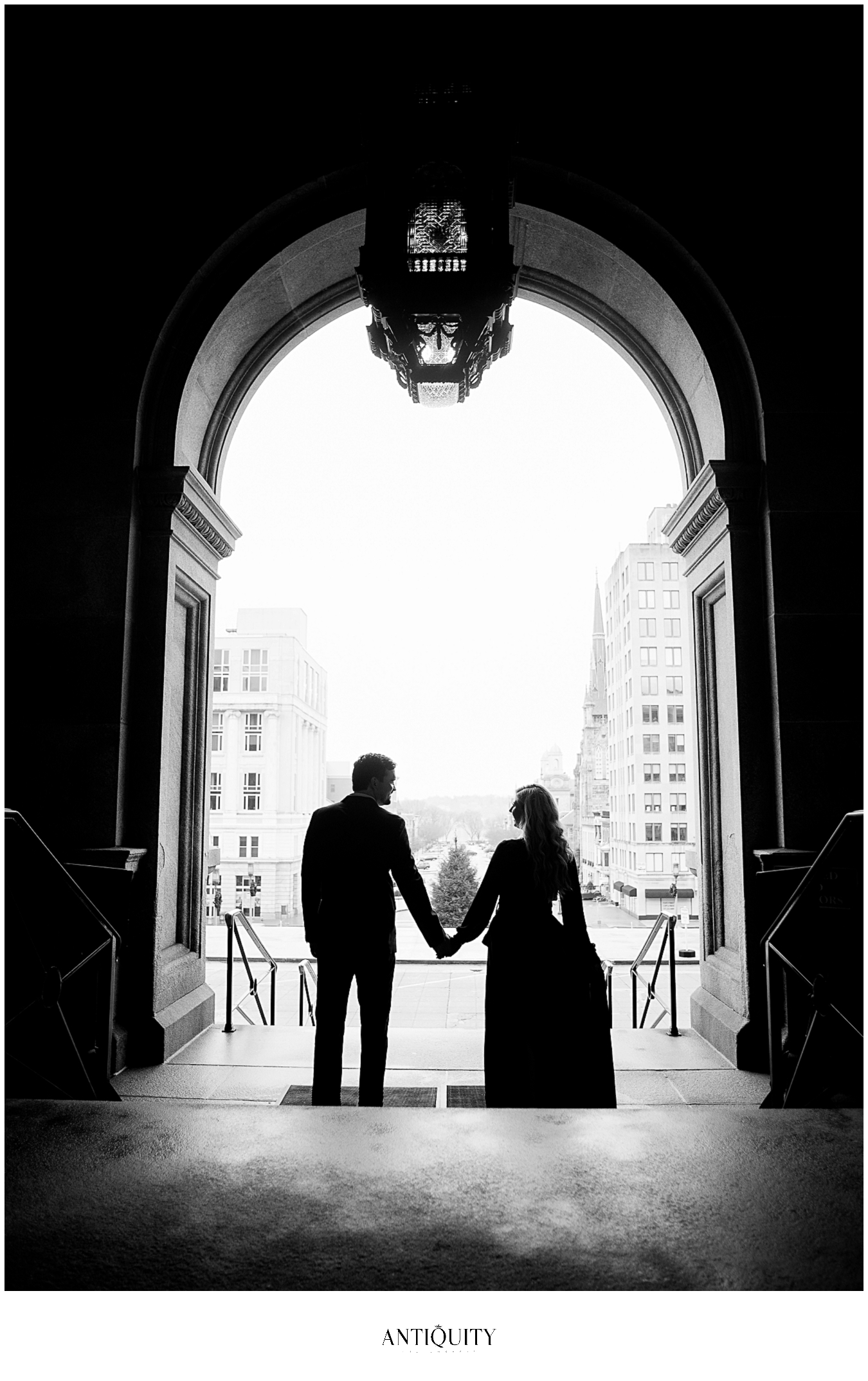 a young couple strolling in front of the capitol building in harrisburg