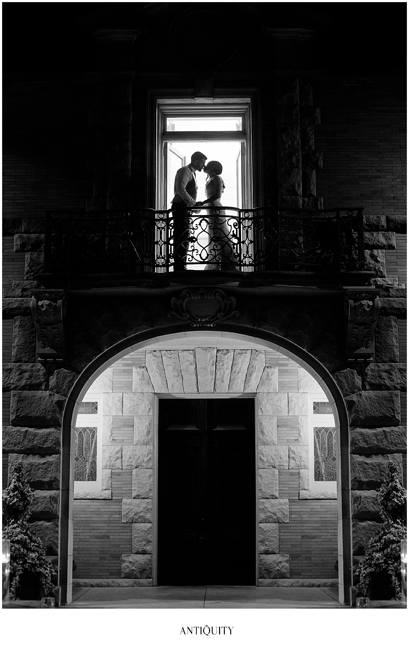 bride and groom on balcony at cairnwood estate