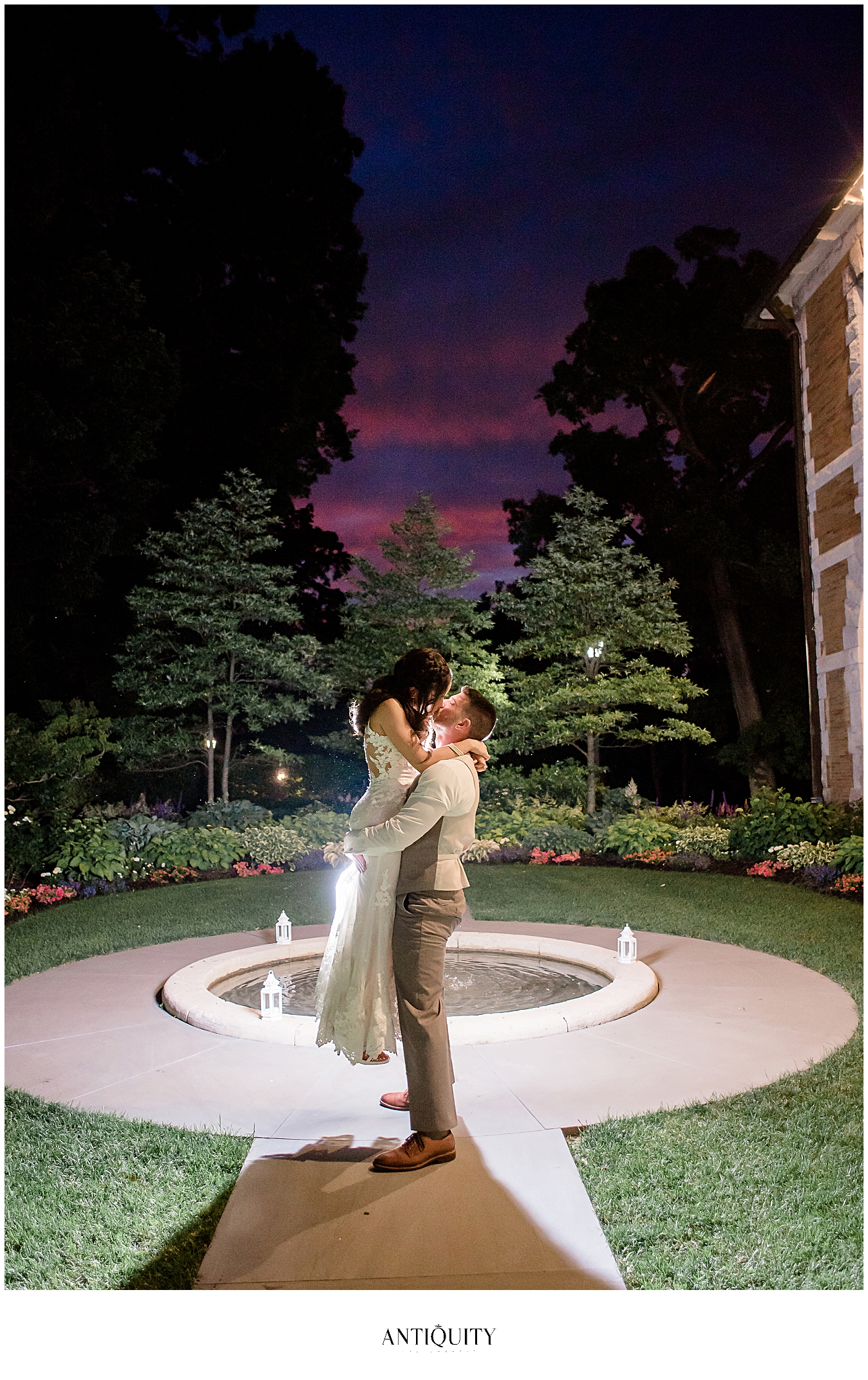 couple in front of fountain at cairnwood estate