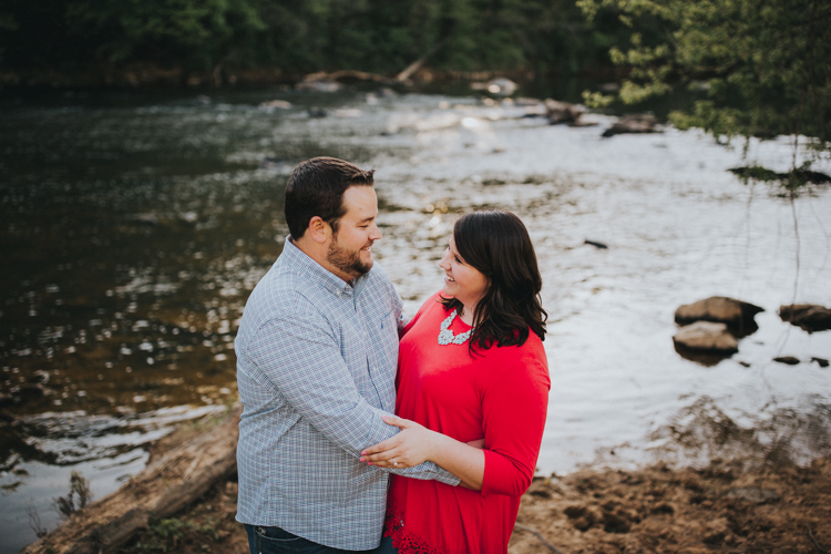 couple next to river in north carolina