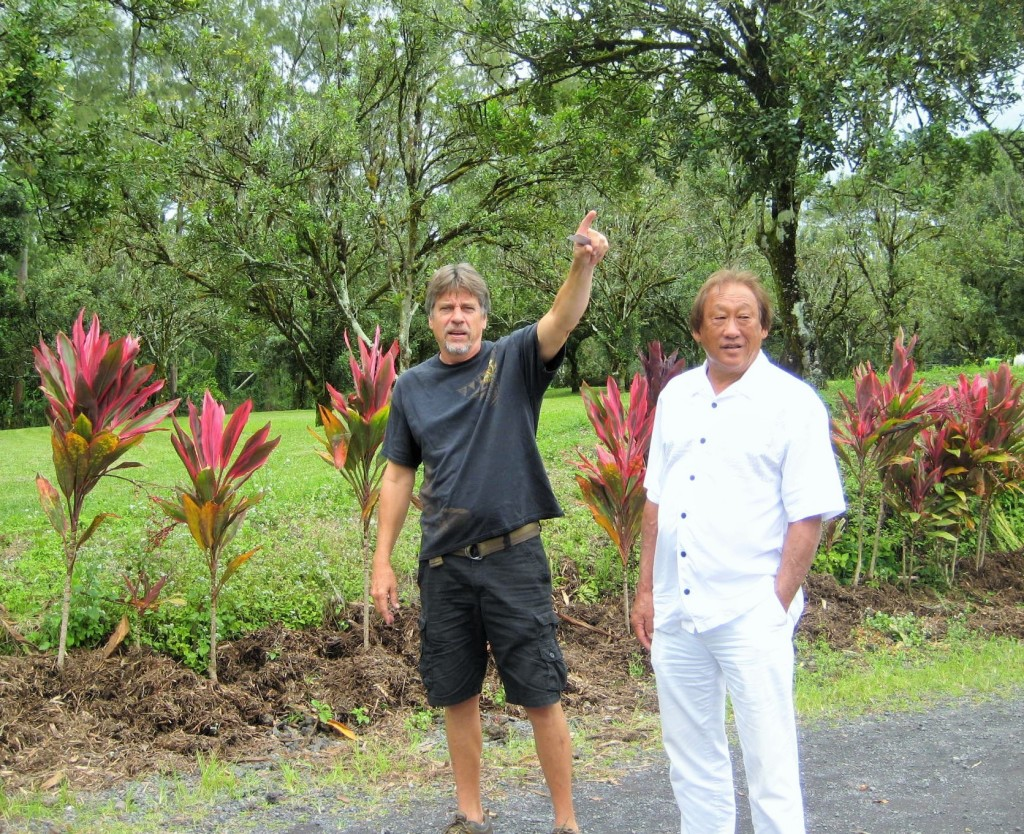 Workplace Readiness Program Director John Theismann points to orchard features with school Director Steve Hirakami