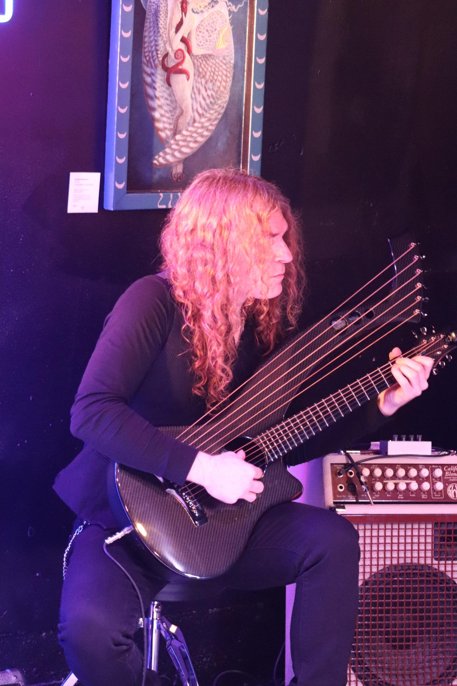 Tim Birtsch of Soul Resonance providing the beautiful harp guitar backdrop