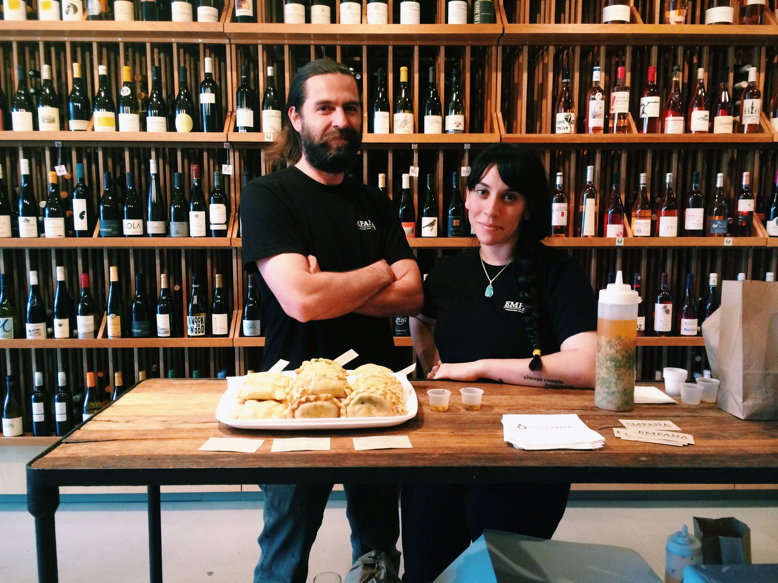Sebastian and Melissa, looking super professional in a wine shop.