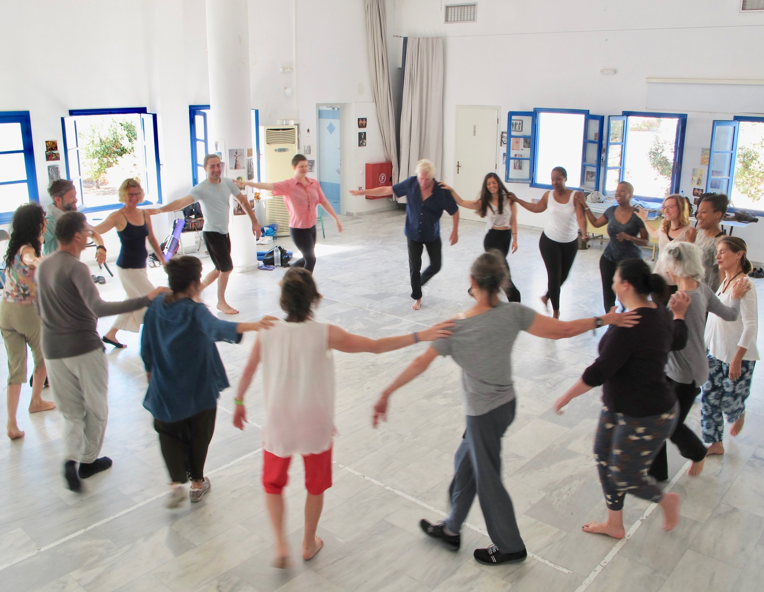 Enjoying a Greek folk dance in our beautiful, sunny (marble floored!) classroom. The space is graciously shared with us by the people of Folegandros.