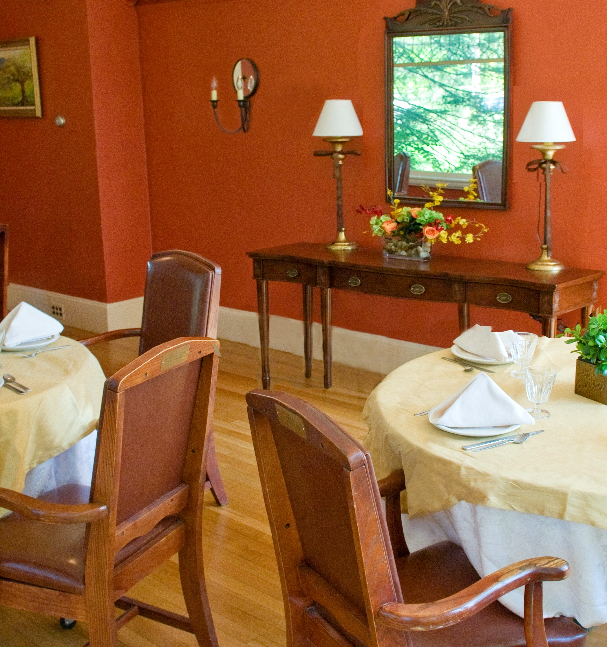 Red tones in a dining room stimulate the appetite as well as conversation.