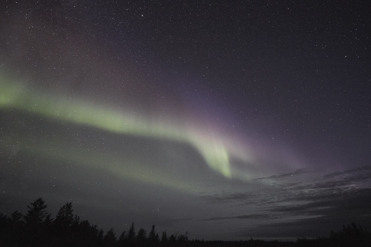This is, not perfect, but that same photograph edited much closer to how I remember actually viewing the aurora in real time with my naked eyes in that moment.  Very  faint greens were visible, and the reds and purples were much more just a different 'hue' than a distinctly identifiable colour.