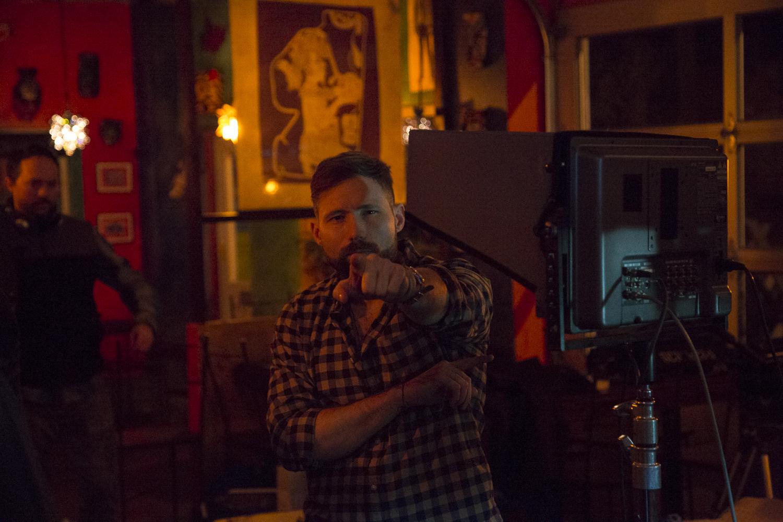 Director Slater Dixon prepping the scene.