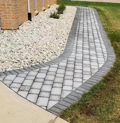 A beautiful walkway with a dark grey border and a light grey inlay -