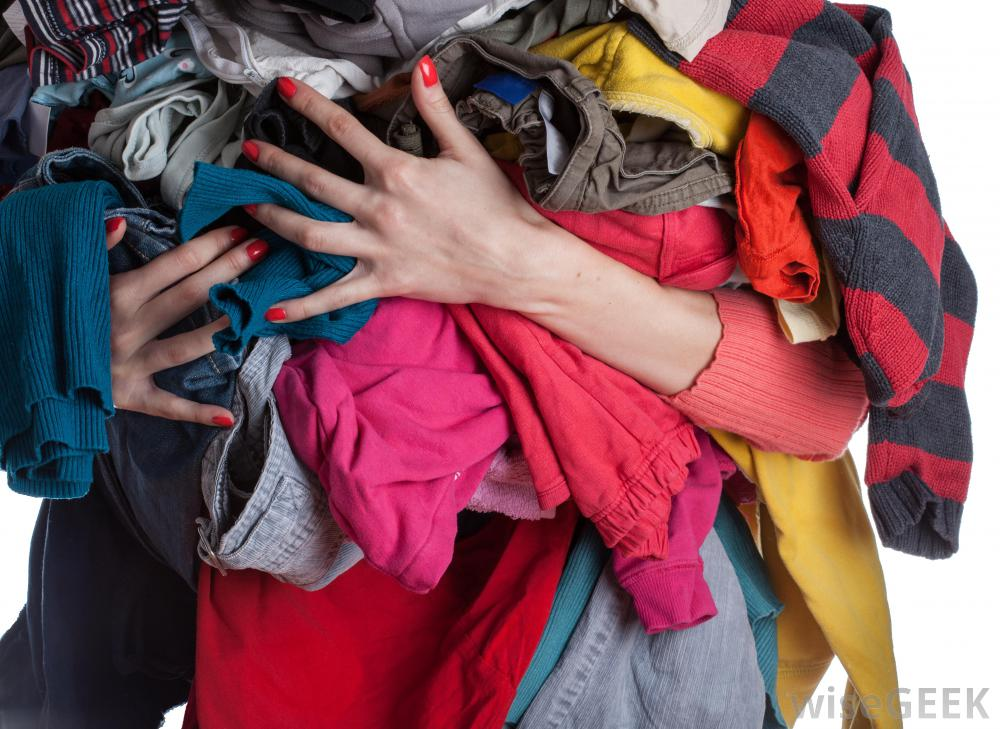 woman-holding-pile-of-clothes.jpg
