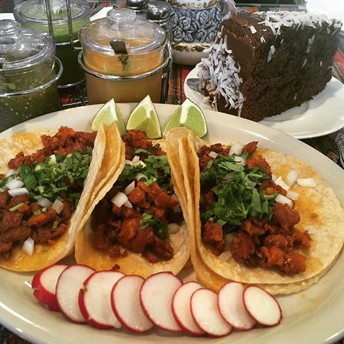CHIRIZO TACOS WITH CILANTRO AND ONIONS FOLLOW BY A RICH CHOCOLATE CAKE