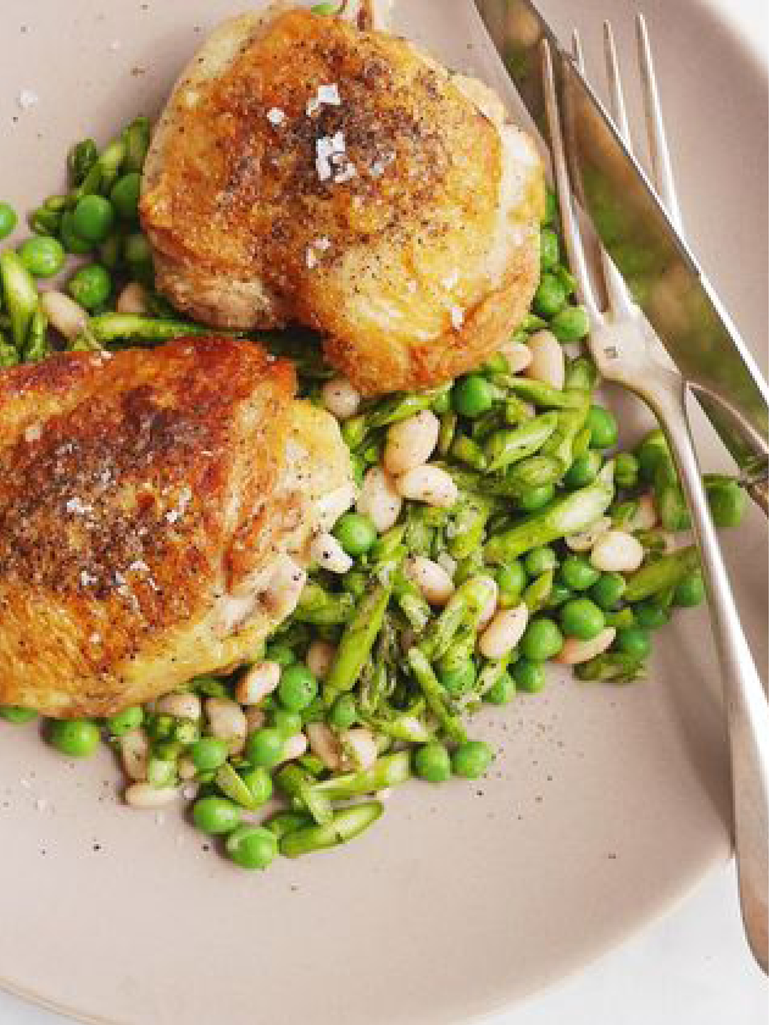 Garlicky Chicken Thighs with Asparagus, Pea, and White Bean Salad  Delish