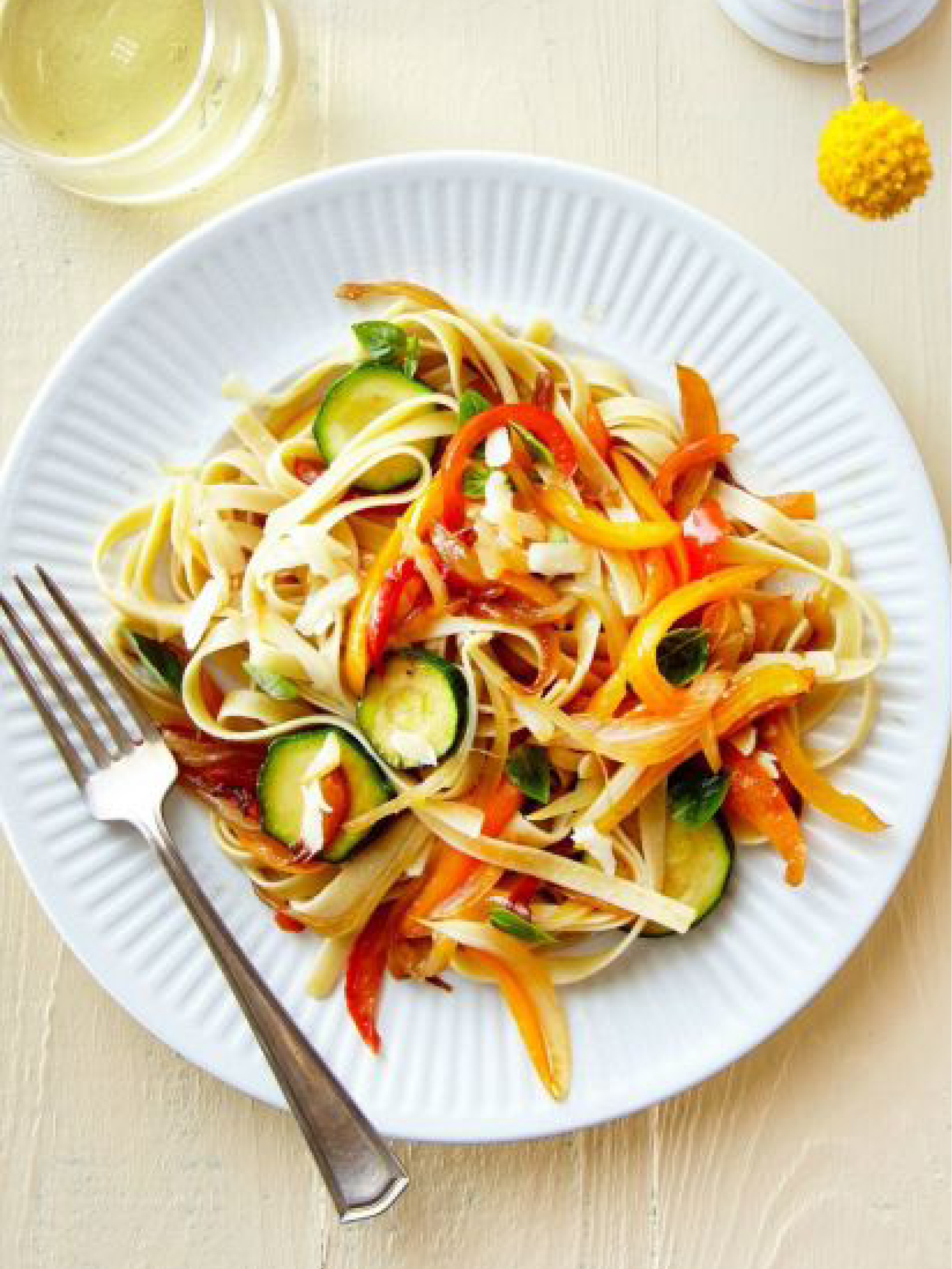 Pasta with Sautéed Peppers, Zucchini, and Smoked Mozzarella  Country Living
