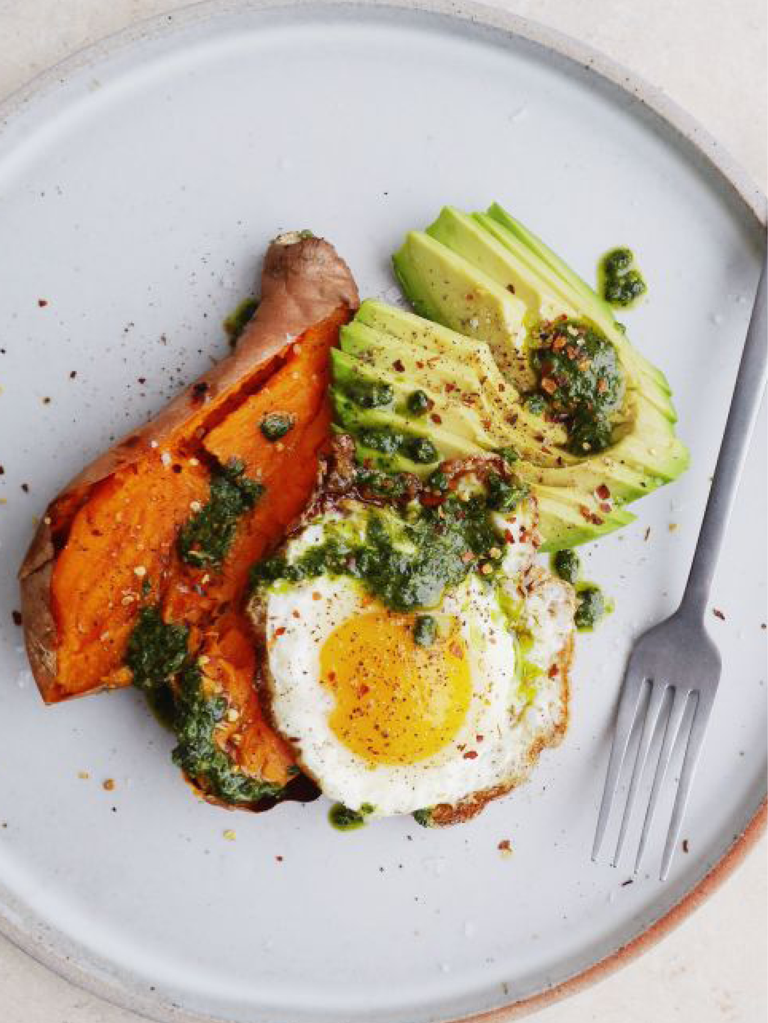 Loaded Baked Sweet Potatoes with Avocado, Pesto and Fried Eggs  Delish