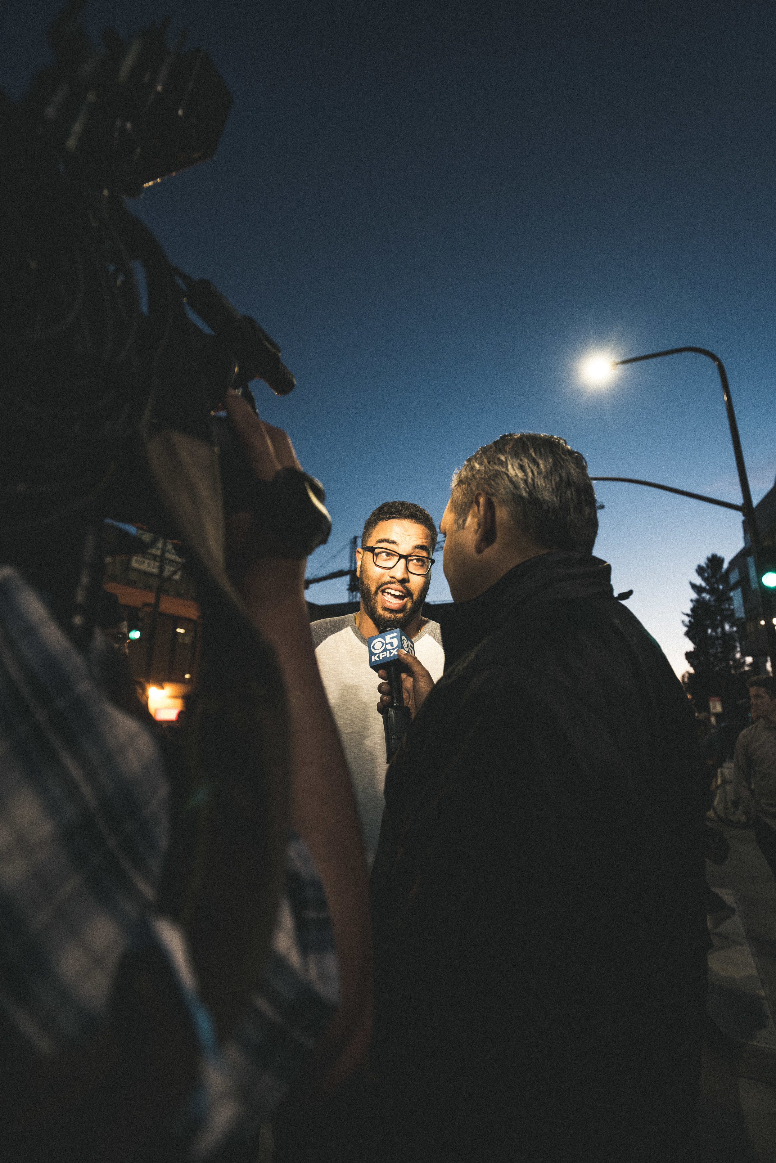 A bystander is interviewed as tensions begin to grow. I later found him to be Muhammad Alameldin.