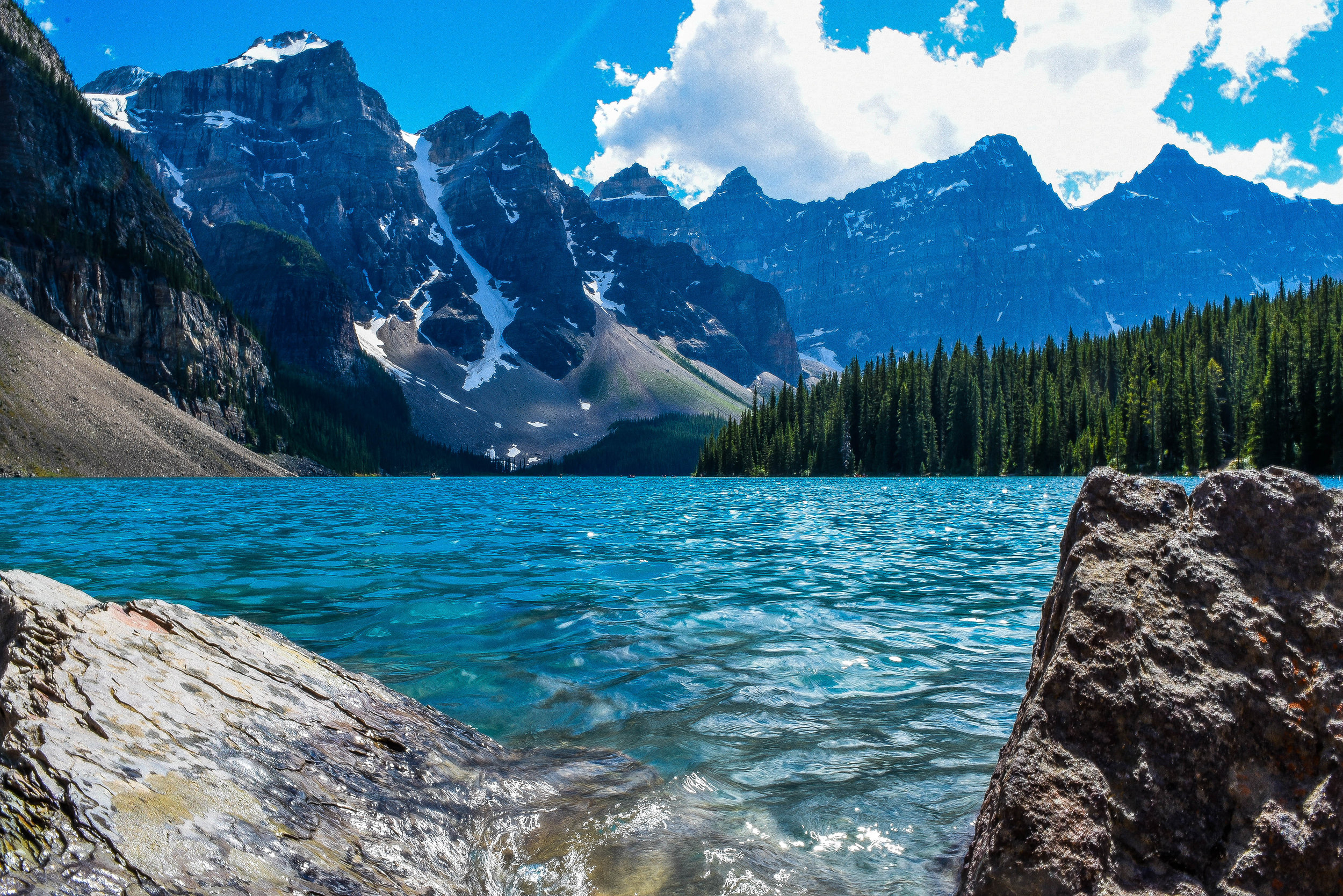 Sunlight bathes the turquoise waters of Banff's Moraine Lake.