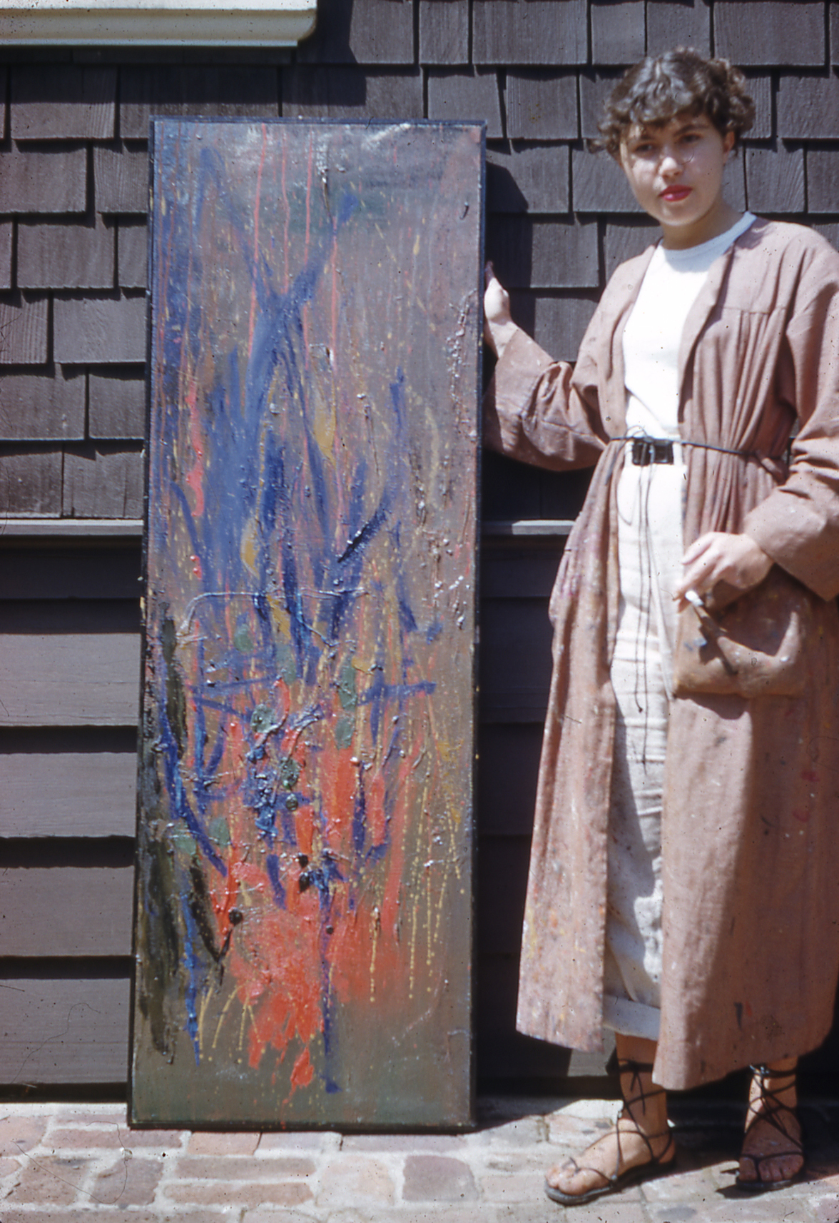 Unknown photographer UC Berkeley student Jay DeFeo standing next to untitled 1951 painting, Berkeley, CA 1951 Reference no. R0417 © 2018 The Jay DeFeo Foundation/Artists Rights Society/ARS, New York.