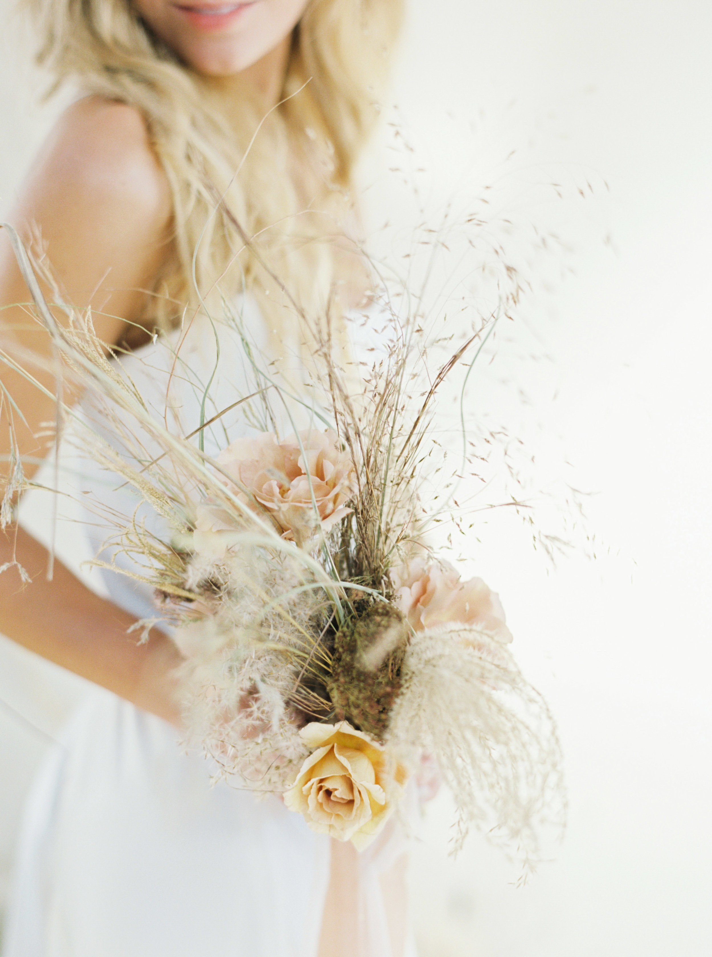 Copy of Autumn colour tones of artisan dried flower art installation with dreamy wedding ceremony backdrop design with trendy pampas grass