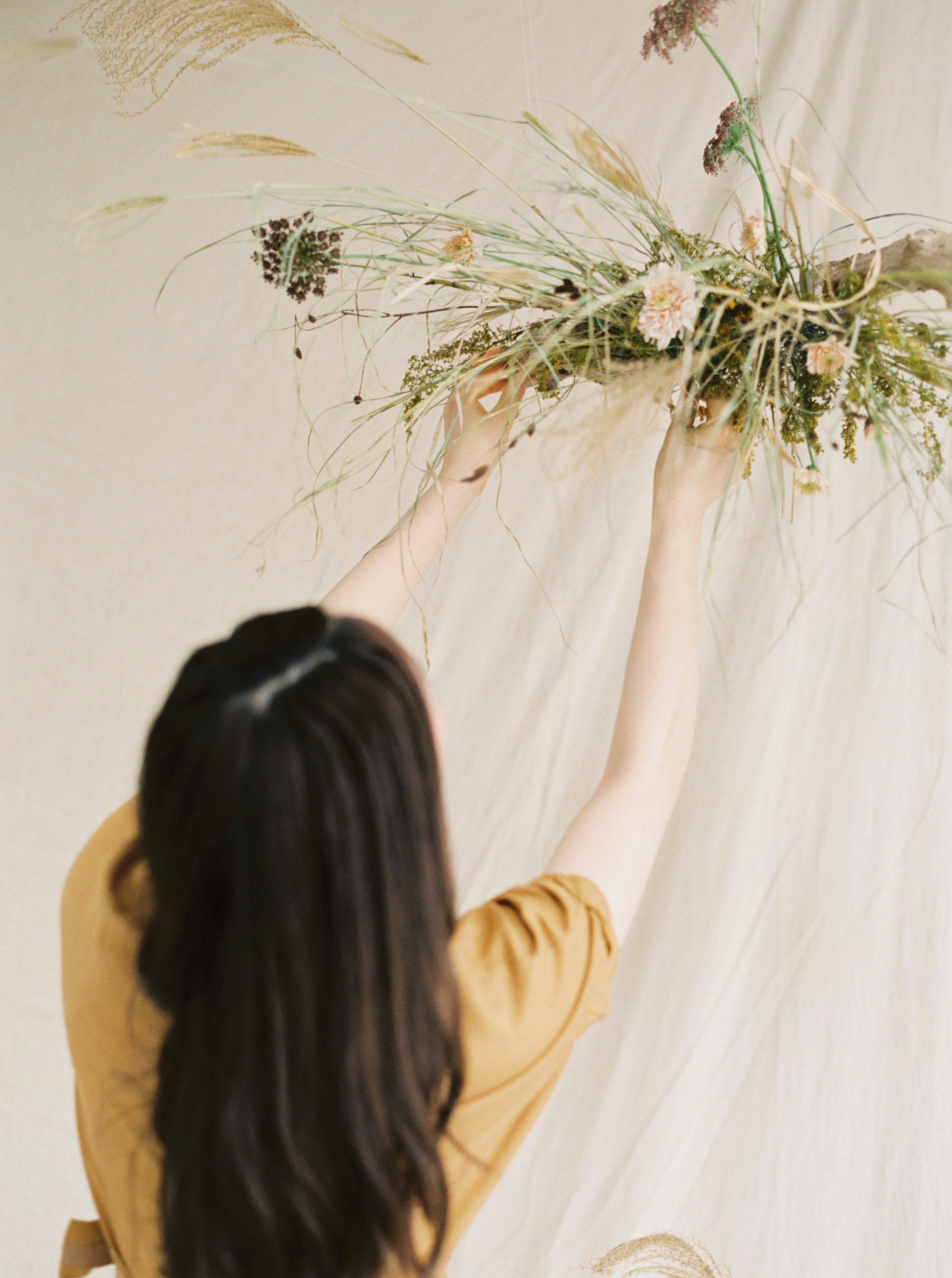 Autumncolourtones of mustard and cream for an artisan dried flower art installation with dreamy wedding ceremony backdrop design with trendy pampas grass at a Sydney wedding photoshoot created and styled by Idyll Flower Studio andPrajnaFlowers - captured on fine art film by Sheri McMahon Photography -