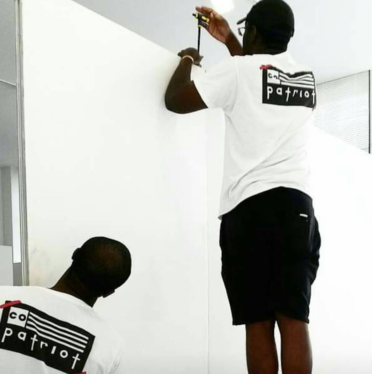 "Jermaine and Stephen installing Stephen's 2014 solo exhibition, ""Co-Patriot"" at Gallery CA in Baltimore, MD."