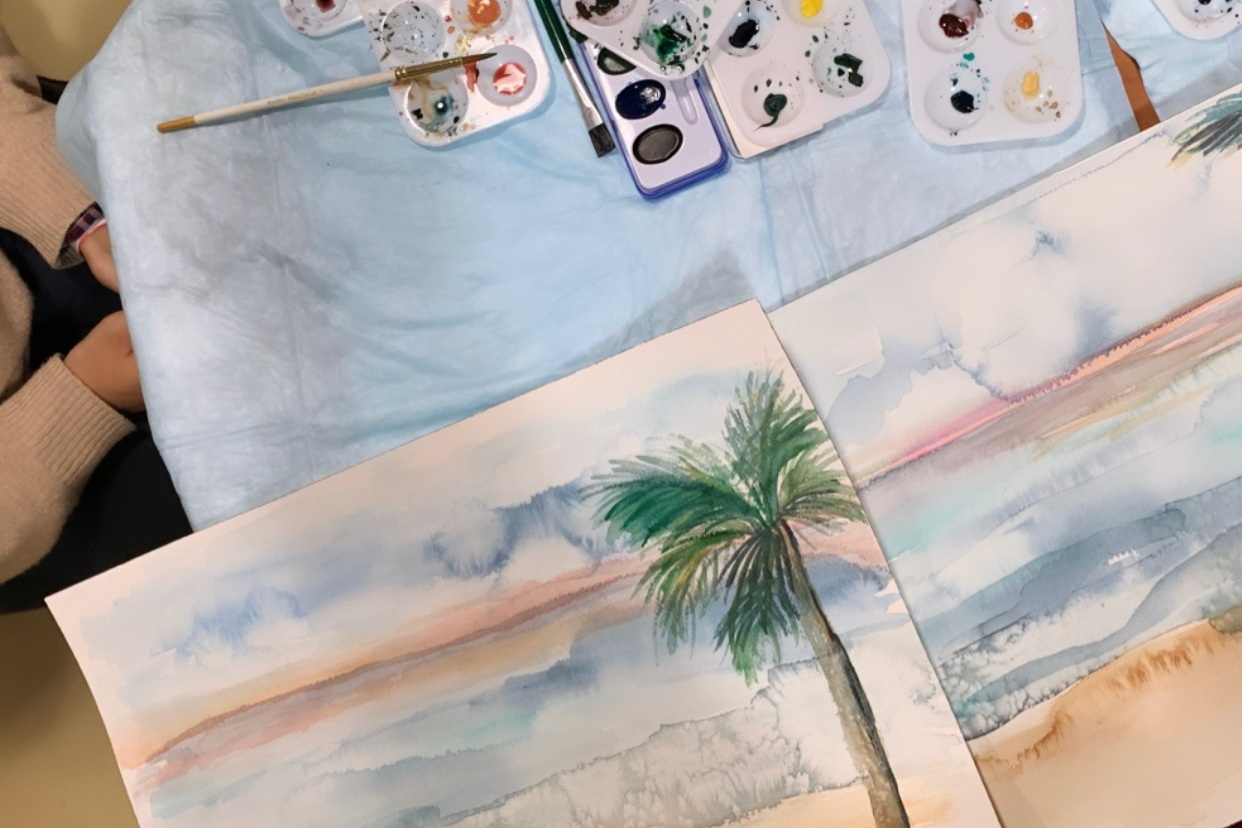 Artist Amanda Hawthorne, of Live Well Paint Often, creates water color painting with patient at NYC Hospital.