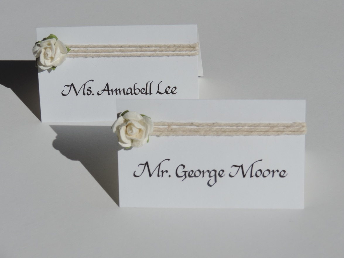 Place cards and table number signs by  Raleigh Calligraphy & Design