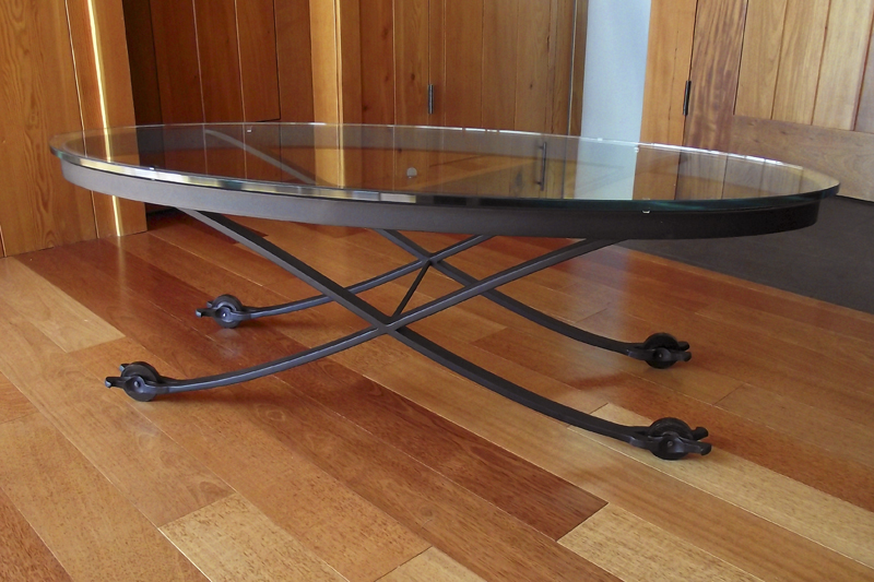 elliptical-sculpted-iron-table-with-turned-ebony-wheels.jpg