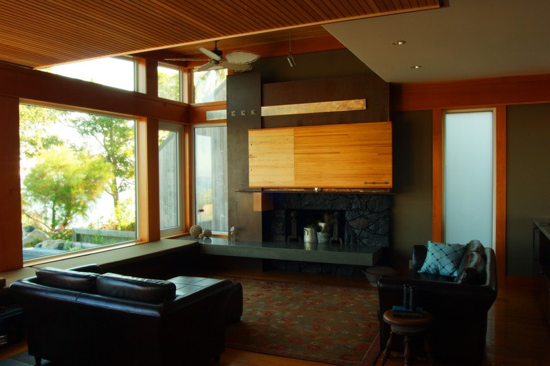 reclaimed bowling alley TV enclosure with graphite-burnished quartz stone fireplace.jpg
