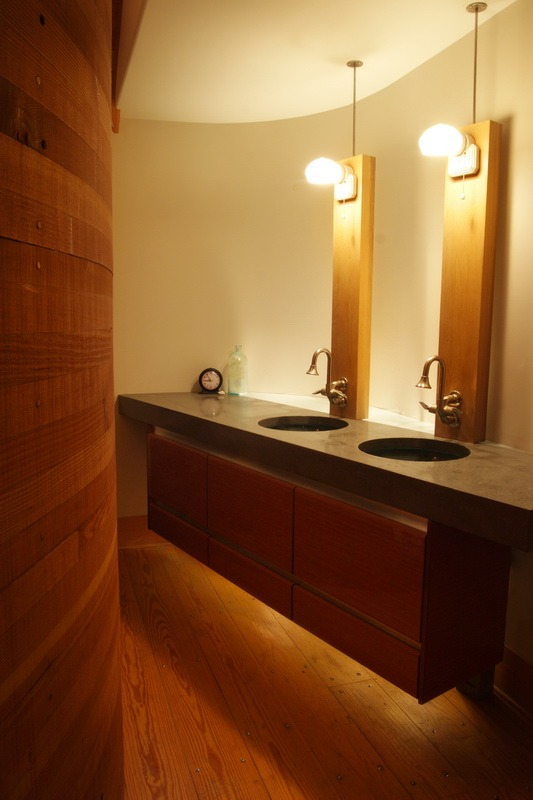 industrial Chicago Brass faucets curved shower wall and under-cabinet illumination.jpg